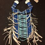 Blue beaded leather breastplate by local artisan