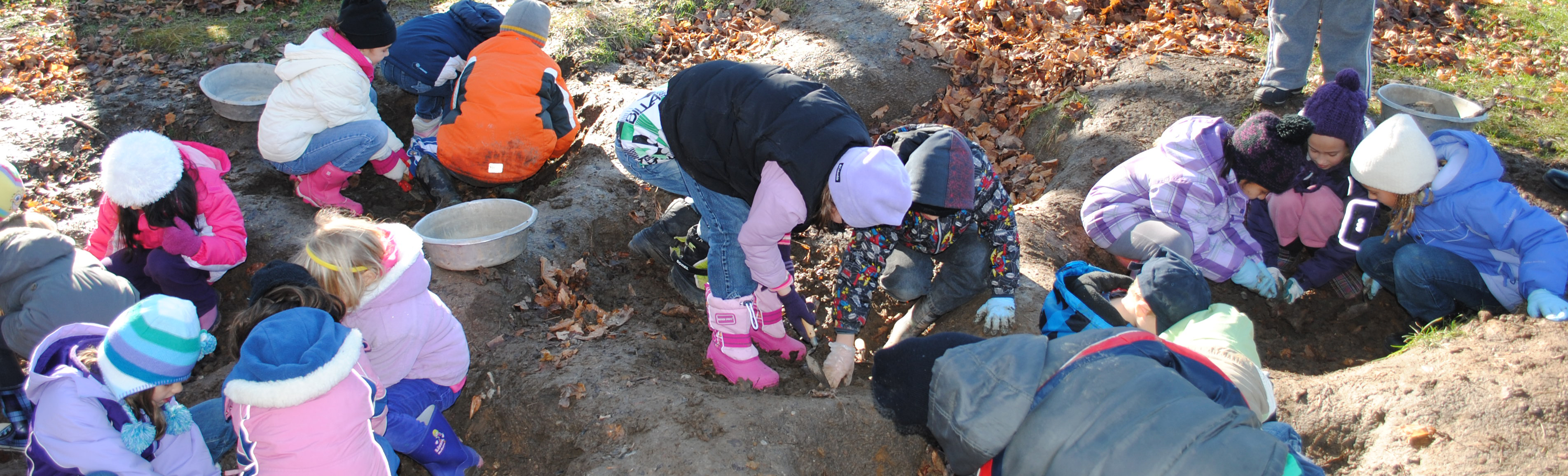 Children learning about archaeology excavation