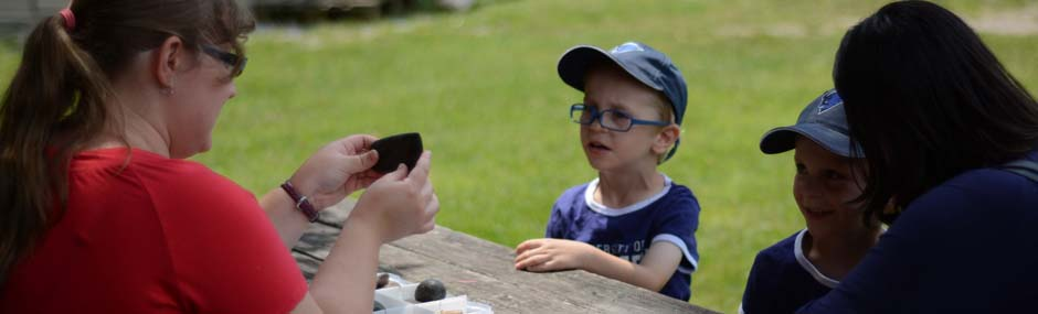 Young boy learning about artifacts