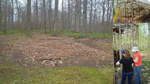 Images of the small longhouse being dismantled and the final area after being cleaned up.