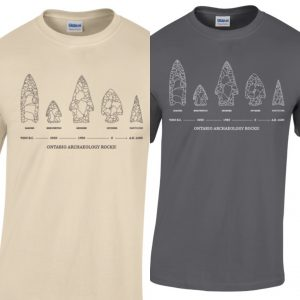 two side by side tshirts one beige and one black. Both with the same image of 5 varying projectile points with the slogan Ontario Archaeology Rocks underneath